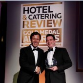 Anton Savage Presents Brian Heaton Castlewood House with the Best Guest House Award